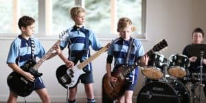 Four boys playing Rock and Popular Music