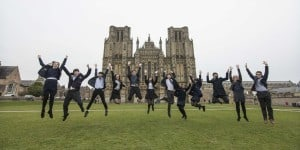 International Students Jumping in Front of Wells Cathedral