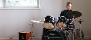 Student playing on the drums in Cedars Hall