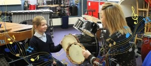 Jayne Obradovic and student playing the tambourine