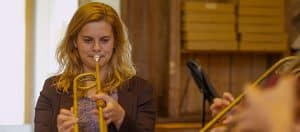 Wells Student Playing a Natural Trumpet