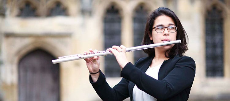 Wells Cathedral School student playing the flute in Vicars' Close