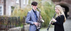 Wells Cathedral School students playing the sax and clarinet in Vicars' Close