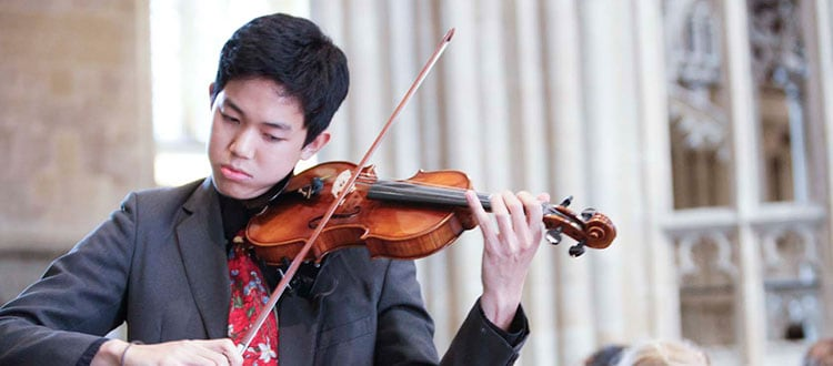 Student playing the violin in Wells Cathedral