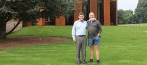 Michael Eavis and Eric Parry outside the newly-built Cedars Hall