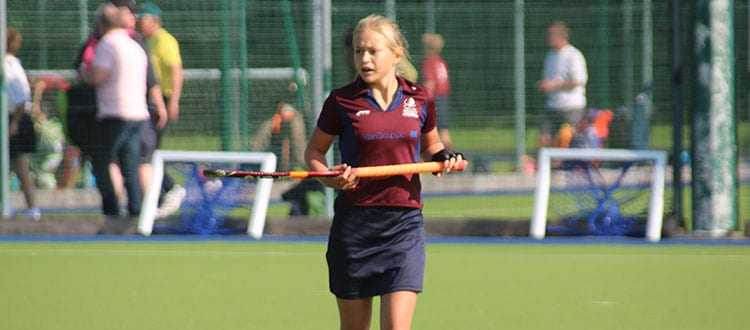 Megan playing hockey