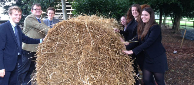 Group with the straw for the mediaeval hut