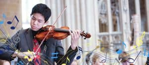 Male Student playing the violin in Wells Cathedral