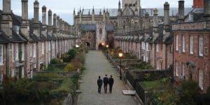 Boys walking down Vicars Close at dusk