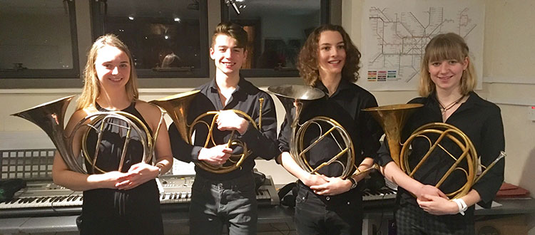 Students holding their French horn