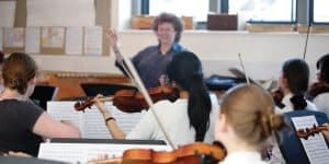 Students playing violin at Wells Music College