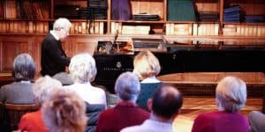 Man performing at the Piano Club at Wells Cathedral School