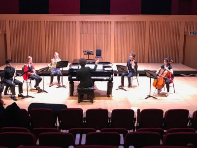Composer with musical group in Cedars Hall