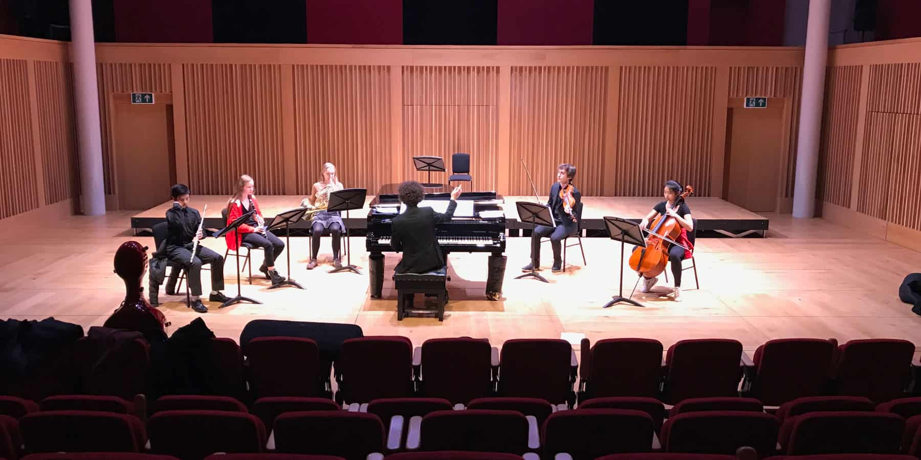Composer with musical group in Cedars Hall; opportunities available at our Wells Music Summer School